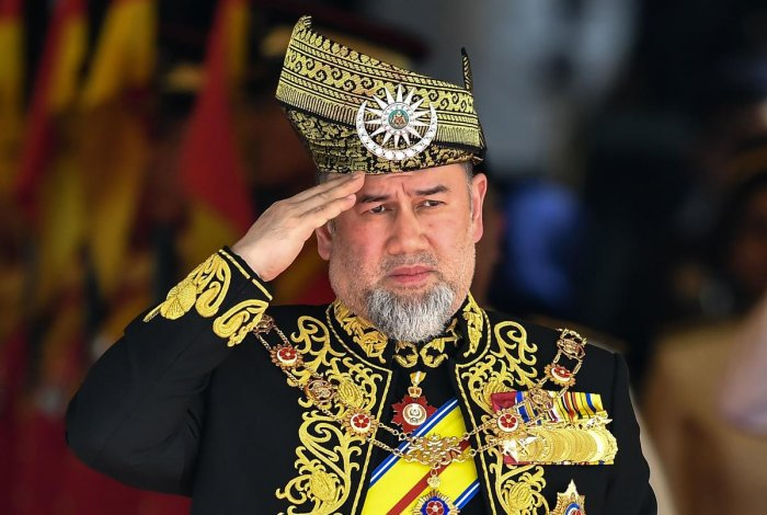 15th king of Malaysia, Sultan Muhammad V, saluting a royal guard of honour during the opening ceremony of the parliament in Kuala Lumpur. AFP file photo