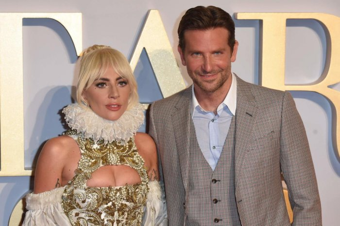 """In this file photo taken on September 27, 2018 US singer and actress Lady Gaga (L) and US actor and filmmaker Bradley Cooper pose on the red carpet upon arrival for the UK premiere of the film """"A Star is Born"""" in central London. - Box office hit music rom"""
