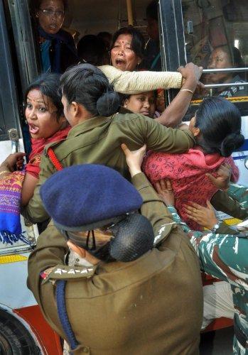 Krishak Mukti Sangram Samiti (KMSS) activists being detained during a protest against the BJP over the Citizenship Amendment Bill 2016 at Hengrabari, in Guwahati, on Sunday. PTI