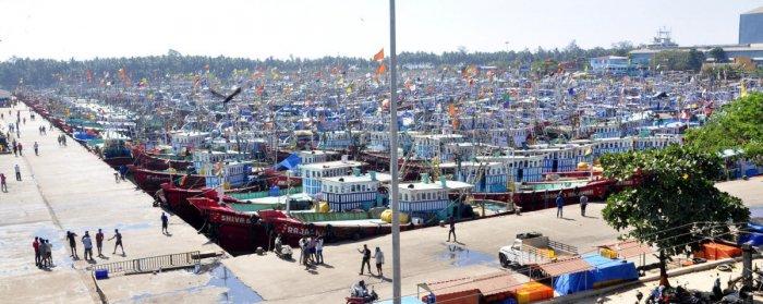 Deep sea fishing boats remain anchored at Malpe harbour