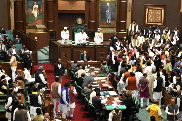 Leaders of opposition protest against the election of Deepak Saxena as pro tem speaker during the winter session of state Assembly, in Bhopal, on Tuesday. Congress MLA N P Prajapati was later elected Speaker of the 15th Madhya Pradesh Legislative Assembly. PTI