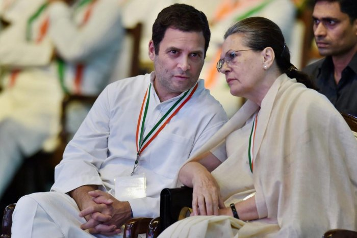 Sonia Gandhi and President Rahul Gandhi talk during the 84th Plenary Session of Indian National Congress. PTI file photo