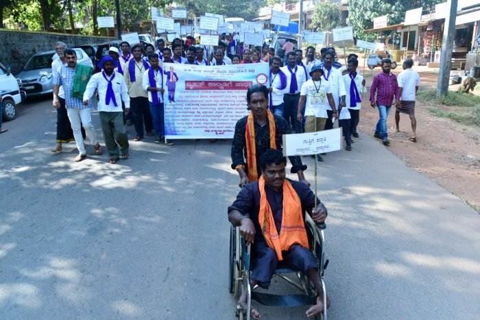 Zilla Dalit Seva Samithi members take out a rally from Vittal to Mangaluru on Monday.