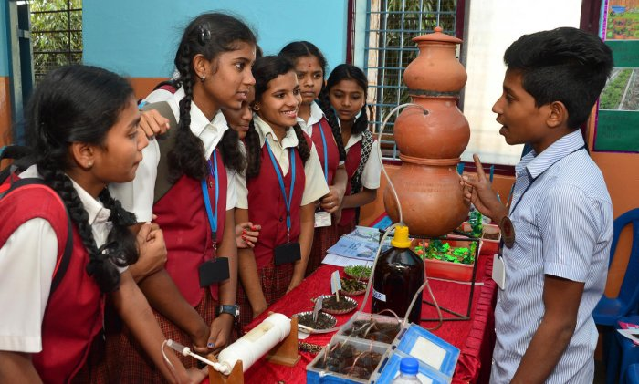 Sakthivel, from a government school in Puducherry, explains about biogas at the Southern India Science Fair held at St Joseph's Indian High School on Monday. (DH Photos/Ranju P)