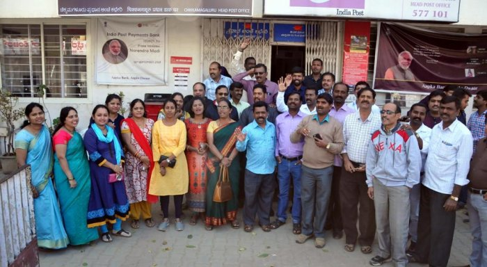 Postal employees stage a protest in Chikkamagaluru on Tuesday.