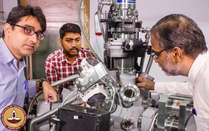IIT Madras team-From left - Prof. Rajnish Kumar, Jyotirmoy Ghosh and Prof. Pradeep around their ultrahigh vacuum instrument
