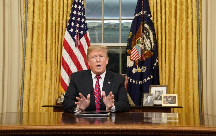 U.S. President Donald Trump delivers a televised address to the nation from his desk in the Oval Office about immigration and the southern U.S. border on the 18th day of a partial government shutdown at the White House in Washington, U.S., January 8, 2019
