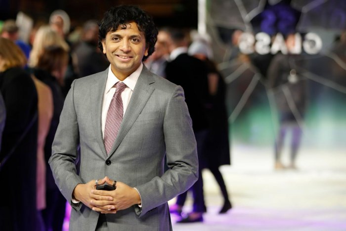 M. Night Shyamalan poses on arrival for the European premiere of Glass in central London. AFP.