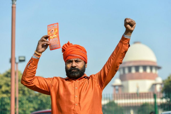 A member of a Hindu group during a protest in support of Ram Temple, near Supreme Court in New Delhi on Thursday. PTI