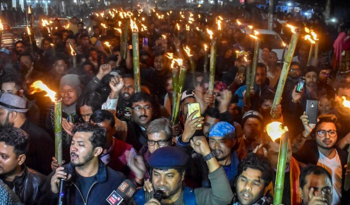 Activists participate in a torch light march in protest against Citizenship (Amendment) Bill, 2016, in Guwahati, Wednesday, Jan 9, 2019. (PTI Photo)