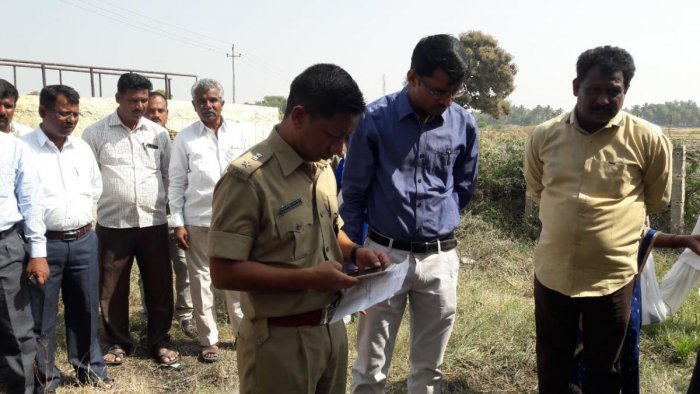 Deputy Commissioner M Kurma Rao at the spot where a well was poisoned at Mudanuru in Hunasagi taluk in Yadgir district on Thursday. (Inset) Honnamma Mallappa Poojari, who died after drinking the water. dh photos