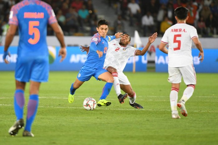 India's forward Sunil Chhetri (C-L) vies for the ball with United Arab Emirates' midfielder Ali Salmeen during the 2019 AFC Asian Cup group A football match between India and UAE at Zayed Sports City stadium in Abu Dhabi. AFP Photo