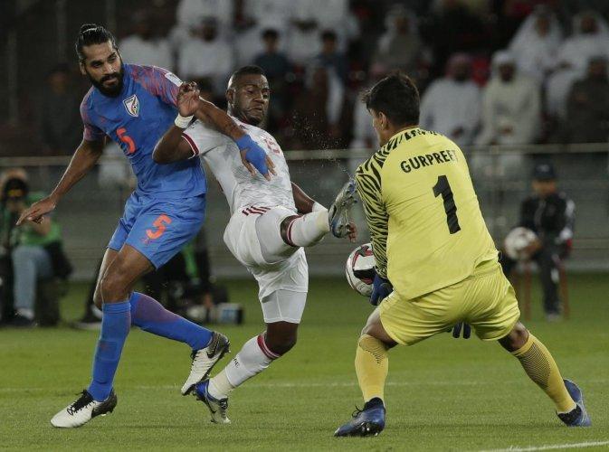 India's goalkeeper Gurpreet Singh Sandhu thwarts United Arab Emirates' Ismail Al Hamadi in the Asian Cup on Thursday.