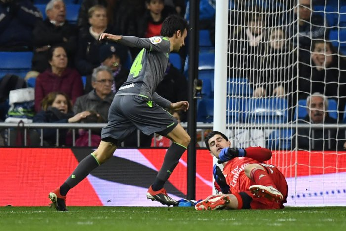 SENSATIONAL: Real Sociedad's Ruben Pardo Gutierrez (left) scores past Real Madrid keeper Thibaut Courtois during their La Liga clash on Sunday. AFP