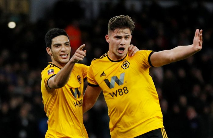 MEXICAN WAVE: Wolverhampton Wanderers' Raul Jimenez (left) celebrates with team-mate Leander Dendoncker after scoring against Liverpool on Monday. REUTERS