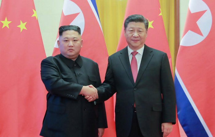 This January 8, 2019 picture released by North Korea's official Korean Central News Agency (KCNA) on January 10 shows North Korea's leader Kim Jong Un (L) shaking hands with China's President Xi Jinping (R) during a welcome ceremony at the Great Hall of t