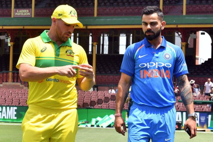Virat Kohli (R) and Aaron Finch (L) arrive for a media call at the Sydney Cricket Ground in Sydney. AFP.