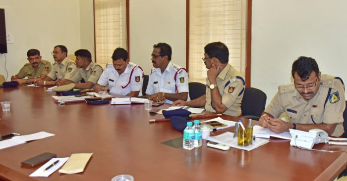 DCP (Law and Order) Hanumantharaya (right) interacts with a caller during the weekly phone-in programme organised by the Mangaluru city police commissionerate on Friday.