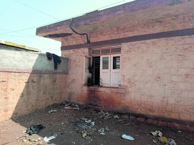 Burglars broke open window grills using gas cutters to gain entry into Veera Pulikeshi Co-operative Bank at Kulageri Cross in Badami taluk, Bagalkot district, late on Thursday night. DH PHOTO