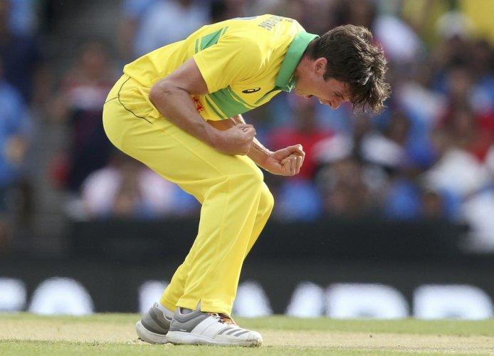 PUMPED UP: Australia's Jhye Richardson celebrates after taking the wicket of India's Ambati Rayudu. AP/PTI