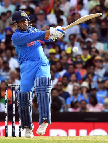 India's Mahendra Singh Dhoni pulls one to fence en route his 96-ball 51 against Australia in the first ODI in Sydney on Saturday. AFP