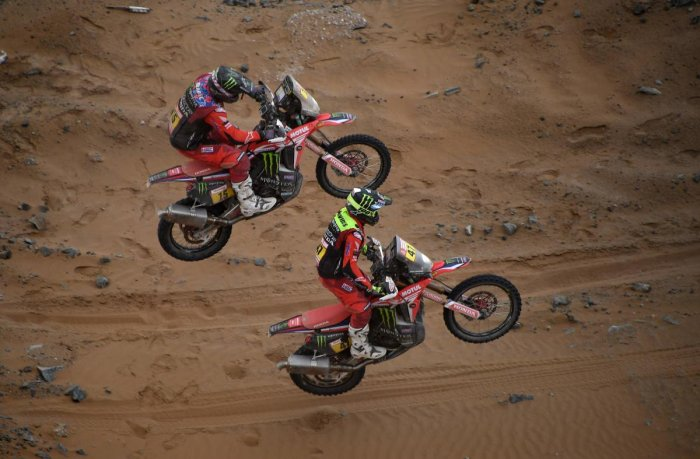 ROARING IN THE AIR: US biker Ricky Brabec and Argentina's Kevin Benavides power their Hondas during Stage 5 of the Dakar Rally. AFP