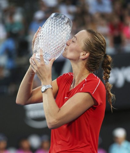 Petra Kvitova of the Czech Republic kisses the trophy after beating Ashleigh Barty of Australia in the final of the Sydney International tournament. AP/PTI