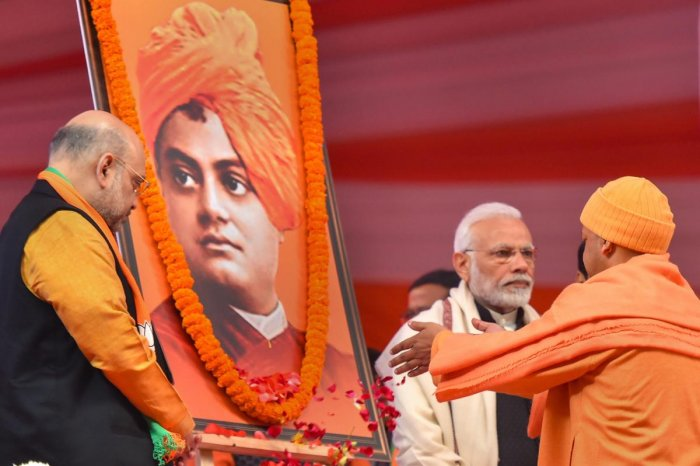 Prime Minister Narendra Modi and BJP President Amit Shah paying tribute to portraits of Swami Vivekananda during the two-day BJP National Convention at Ramlila Ground , in New Delhi. PTI