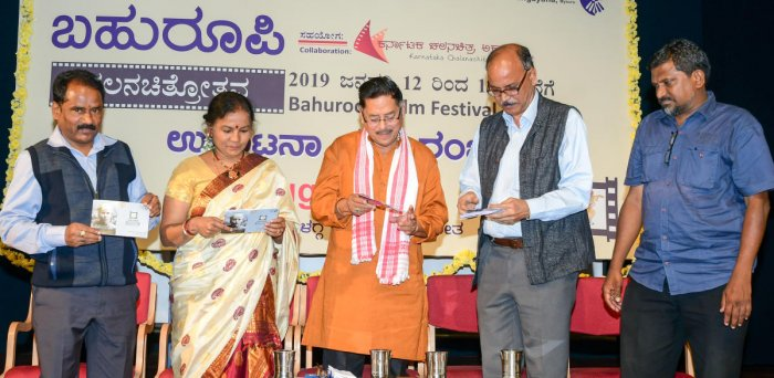 Grand opening: Film critic N Vidyashankar releasing a brochure during the inauguration of the Film Festival, organised as part of Bahuroopi National theatre festival-2019, at Bhoomigeetha in Mysuru, on Saturday. Actor Ramesh Bhat, Joint Director of Rangay