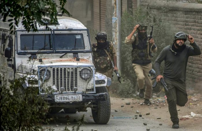 """""""As the cordon was being laid and forces tried to approach towards the suspected spot, the militants hiding inside opened fire, triggering a fierce encounter in which so far two militants were killed,"""" they said and identified the slain ultras as Zeenat and Shakeel Ahmad Dar alias Faisal."""