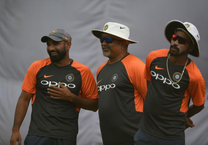 MAN WITH A GOLDEN TOUCH: India bowling coach Bharat Arun (centre) may be seen joking about quite often during 'nets' session but that has never stopped him from making keen observations of his pacers. AFP