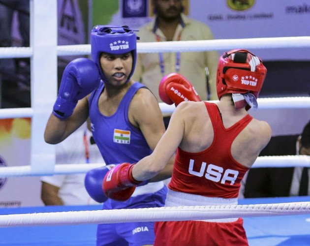 SUPERB START: India's Manisha Moun (left) attempts to land a blow on Christina Cruz during their 54kg bout on Friday. PTI
