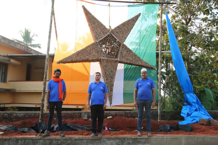 Three youth with Christmas Star at Mount Carmel Church in Shirthady.