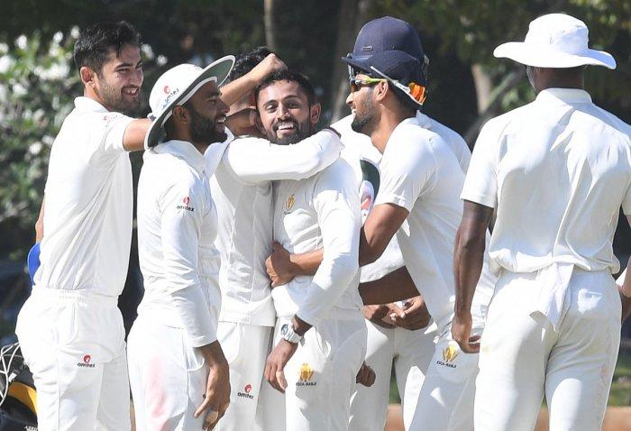 Karnataka's Shreyas Gopal (centre) being congratulated by his team-mates after dismissing Chhattisgarh's Amandeep Khare on Wednesday. DH Photo/ Srikanta Sharma R