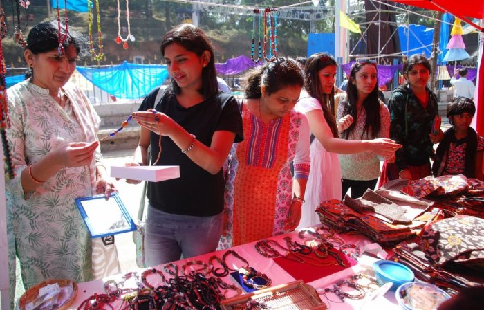 Tourists purchase chains and bags at the open street festival in Madikeri on Sunday.