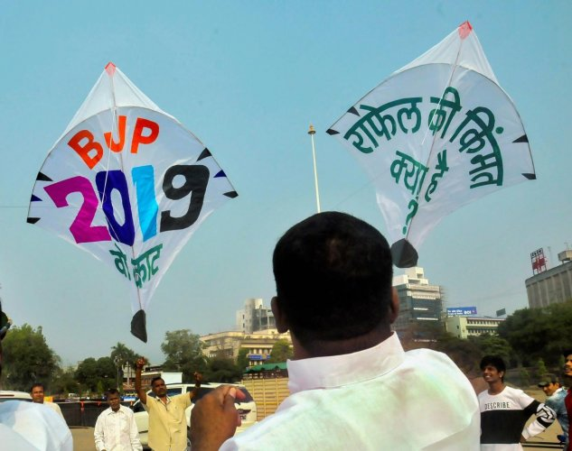 A Congress supporter flies a kite asking to address Rafael Deal scam, ahead of Makar Sankranti festival in Nagpur on Sunday. PTI file photo