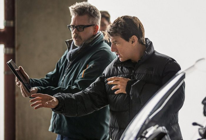 Christopher McQuarrie and actor Tom Cruise interact behind a scene on the set of Mission Impossible - Fallout. PTI/Paramount Pictures.