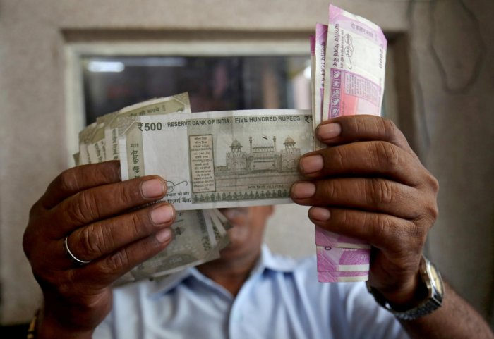 The rupee depreciated by 10 paise and fell below the 71 per dollar mark in opening trade Tuesday amid strengthening greenback, sustained foreign fund outflows and surging crude oil prices. Reuters file photo