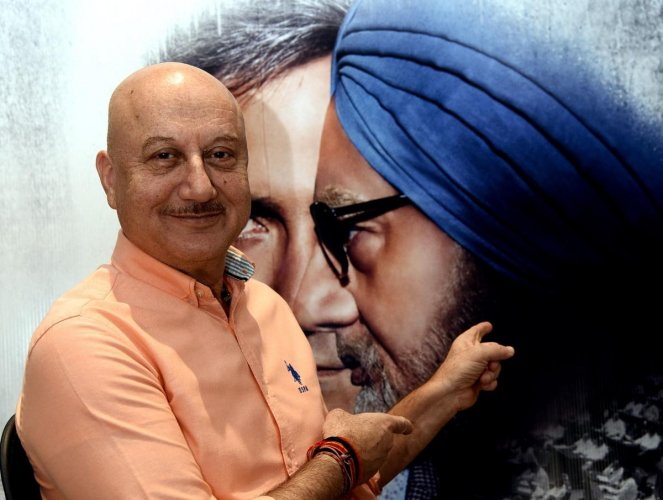 Bollywood actor Anupam Kher poses for a picture during a promotional event for 'The Accidental Prime Minister', (AFP Photo)