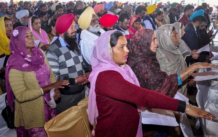 Sarpanch and Panchs take othe during the swearing-in ceremony at Baran village, Patiala district, Friday, Jan. 11, 2019.