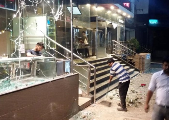 Restaurant staff clean the premises after the fight with delivery executives.