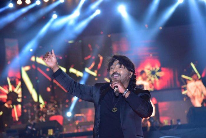 Music director Arjun Janya entertains the audience as apart of the Kodagu Pravasi Utsav 2019 at Gandhi Maidan in Madikeri.
