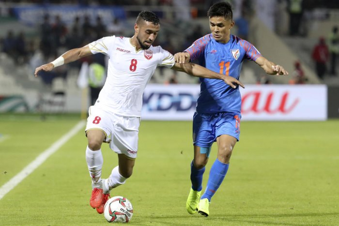 BATTLING SHOW: India's Sunil Chhetri (right) attempts to stop Bahrain's Mohammad Marhoon during their AFC Asian Cup clash on Monday. AFP