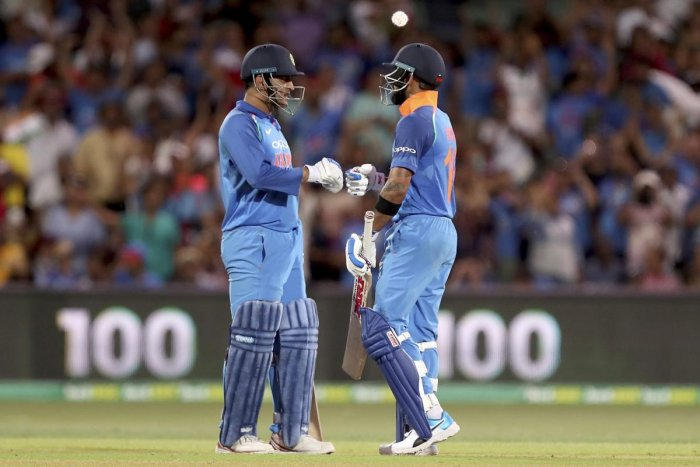 India's Virat Kohli celebrates his 100 against Australia with teammate M.S. Dhoni during their one day international cricket match in Adelaide, Australia, Tuesday, Jan. 15, 2019. (AP/PTI)