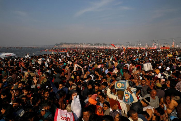 "Devotees arrive to take a dip during the first ""Shahi Snan"" (grand bath) at ""Kumbh Mela"" or the Pitcher Festival, in Prayagraj, previously known as Allahabad, India, January 15, 2019. (REUTERS)"