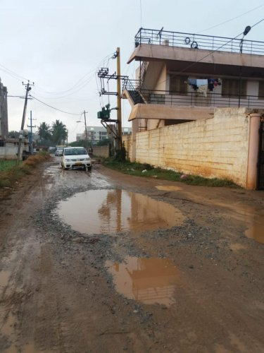 The unasphalted Thubarahalli Road where residents struggle to commute, especially during the rain.