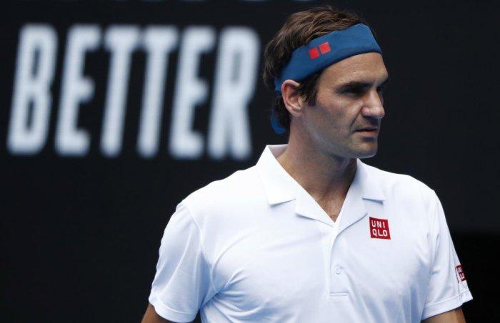 Australian Open - Second Round - Melbourne Park, Melbourne, Australia, January 16, 2019. Switzerland's Roger Federer reacts during the match against Britain's Dan Evans. REUTERS
