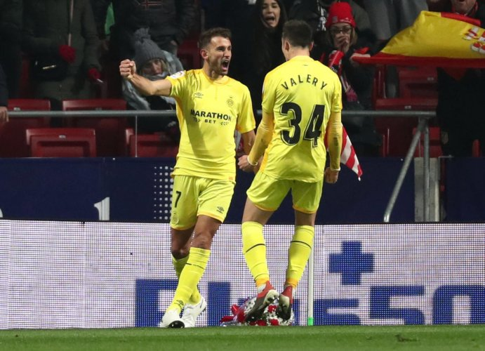 Girona's Cristhian Stuani celebrates with team-mate Valery Fernandez after scoring against Atletico Madrid on Wednesday. REUTERS