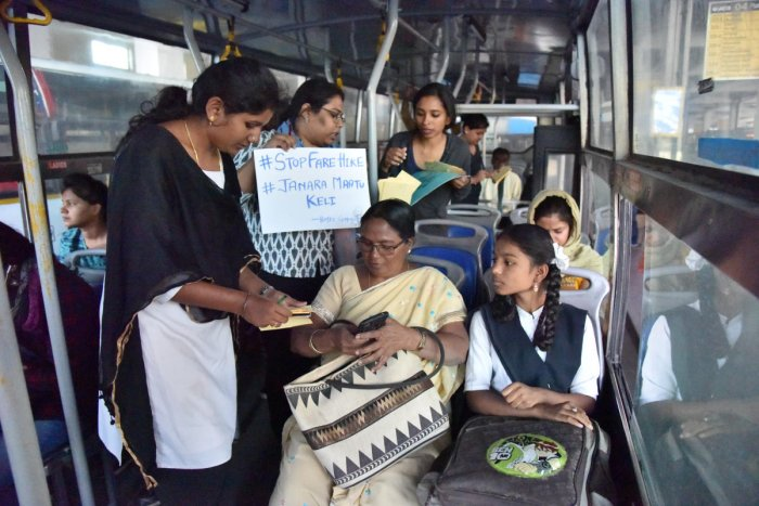 Volunteers run a postcard campaign in Shivajinagar on Wednesday. DH PHOTO/JANARDHAN B K