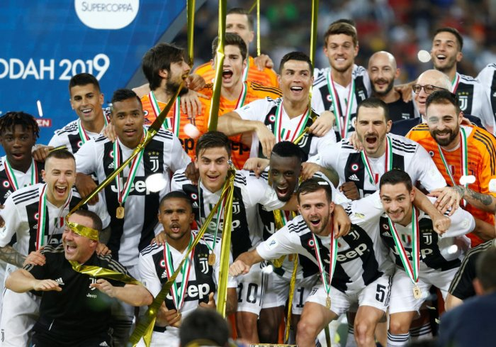 Juventus players celebrate after winning the Italian Super Cup. (Reuters Photo)